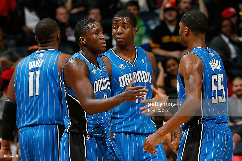 <a gi-track='captionPersonalityLinkClicked' href=/galleries/search?phrase=Victor+Oladipo&family=editorial&specificpeople=6681560 ng-click='$event.stopPropagation()'>Victor Oladipo</a> #5 of the Orlando Magic reacts after drawing a foul on a dunk against the Atlanta Hawks with <a gi-track='captionPersonalityLinkClicked' href=/galleries/search?phrase=E%27Twaun+Moore&family=editorial&specificpeople=4877476 ng-click='$event.stopPropagation()'>E'Twaun Moore</a> #55 at Philips Arena on November 26, 2013 in Atlanta, Georgia.