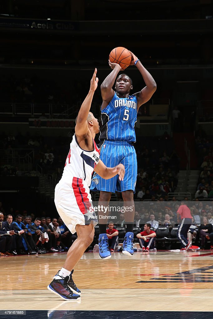 <a gi-track='captionPersonalityLinkClicked' href=/galleries/search?phrase=Victor+Oladipo&family=editorial&specificpeople=6681560 ng-click='$event.stopPropagation()'>Victor Oladipo</a> #5 of the Orlando Magic shoots the ball against the Washington Wizards during the game at the Verizon Center on February 25, 2014 in Washington, DC.
