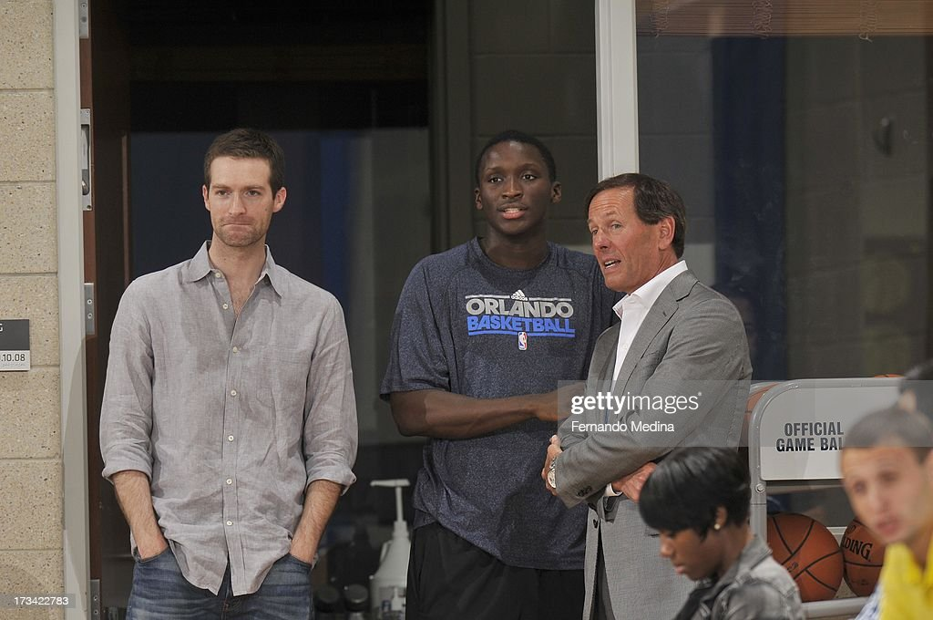<a gi-track='captionPersonalityLinkClicked' href=/galleries/search?phrase=Victor+Oladipo&family=editorial&specificpeople=6681560 ng-click='$event.stopPropagation()'>Victor Oladipo</a> #5 of the Orlando Magic watches the game during the 2013 Southwest Airlines Orlando Pro Summer League game between the Oklahoma City Thunder and the Houston Rockets on July 12, 2013 at Amway Center in Orlando, Florida.
