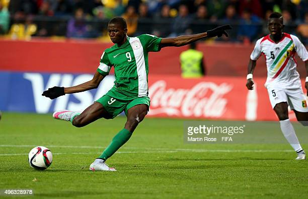 Victor Osimhen of Nigeria is scoring the opening goal during the FIFA U17 Men's World Cup 2015 final match between Mali and Nigeria at Estadio...