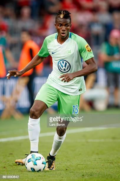 Victor Osimhen of Wolfsburg runs with the ball during the Bundesliga match between Bayer 04 Leverkusen and VfL Wolfsburg at BayArena on October 15...