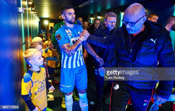Victor Palsson of Esbjerg fB shake hands with Olafur Kristjansson head coach of Randers FC in the players tunnel prior to the Danish Alka Superliga...