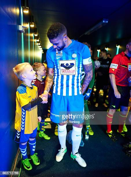 Victor Palsson of Esbjerg fB shake hands with the young mascot in the players tunnel prior to the Danish Alka Superliga match between Esbjerg fB and...
