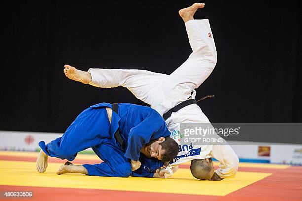 Victor Penalber of Brazil throws Gadiel Miranda of Puerto Rico during their bronze medal contest in the men's judo 81kg class at the 2015 Pan...