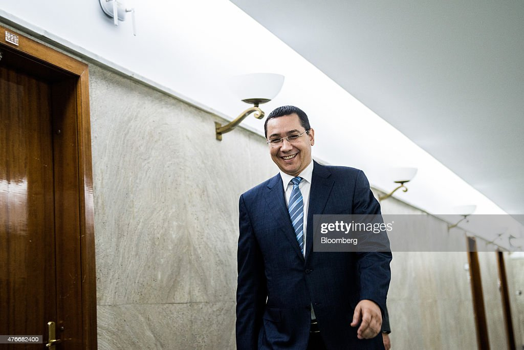 Victor Ponta, Romania's prime minister, exits following an interview at the Victoria Palace in Bucharest, Romania, on Thursday, June 11, 2015. A protracted political crisis in Romania would threaten to slow the European Unions fastest economic growth, according to Ponta, who faces a no-confidence motion on Friday. Photographer: Akos Stiller/Bloomberg via Getty Images