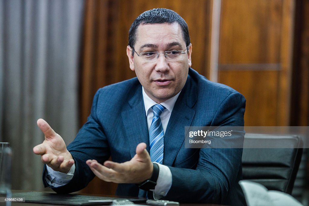 <a gi-track='captionPersonalityLinkClicked' href=/galleries/search?phrase=Victor+Ponta&family=editorial&specificpeople=6752065 ng-click='$event.stopPropagation()'>Victor Ponta</a>, Romania's prime minister, gestures whilst speaking during an interview at the Victoria Palace in Bucharest, Romania, on Thursday, June 11, 2015. A protracted political crisis in Romania would threaten to slow the European Unions fastest economic growth, according to Ponta, who faces a no-confidence motion on Friday. Photographer: Akos Stiller/Bloomberg via Getty Images