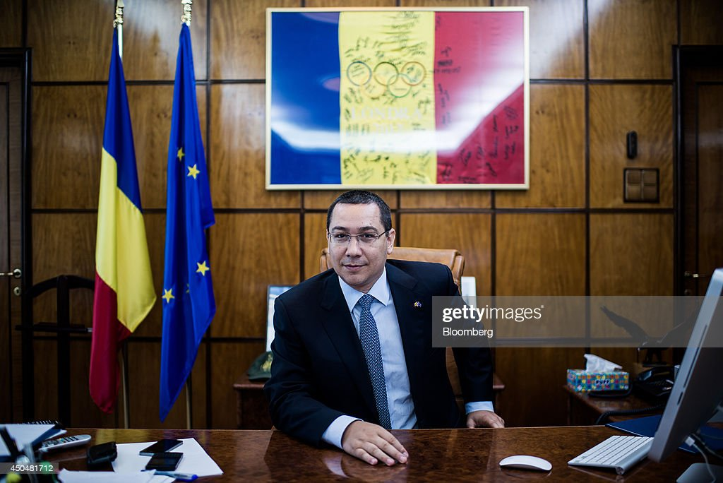 Victor Ponta, Romania's prime minister, pauses during an interview at the Victoria Palace in Bucharest, Romania, on Thursday, June 12, 2014. Romania is considering the sale in 2015 of further shares in state-controlled companies including Transelectrica SA, Romgaz SA and Transgaz SA, according to Ponta, who said the government may be left with stakes of less than 50 percent in some. Photographer: Akos Stiller/Bloomberg via Getty Images