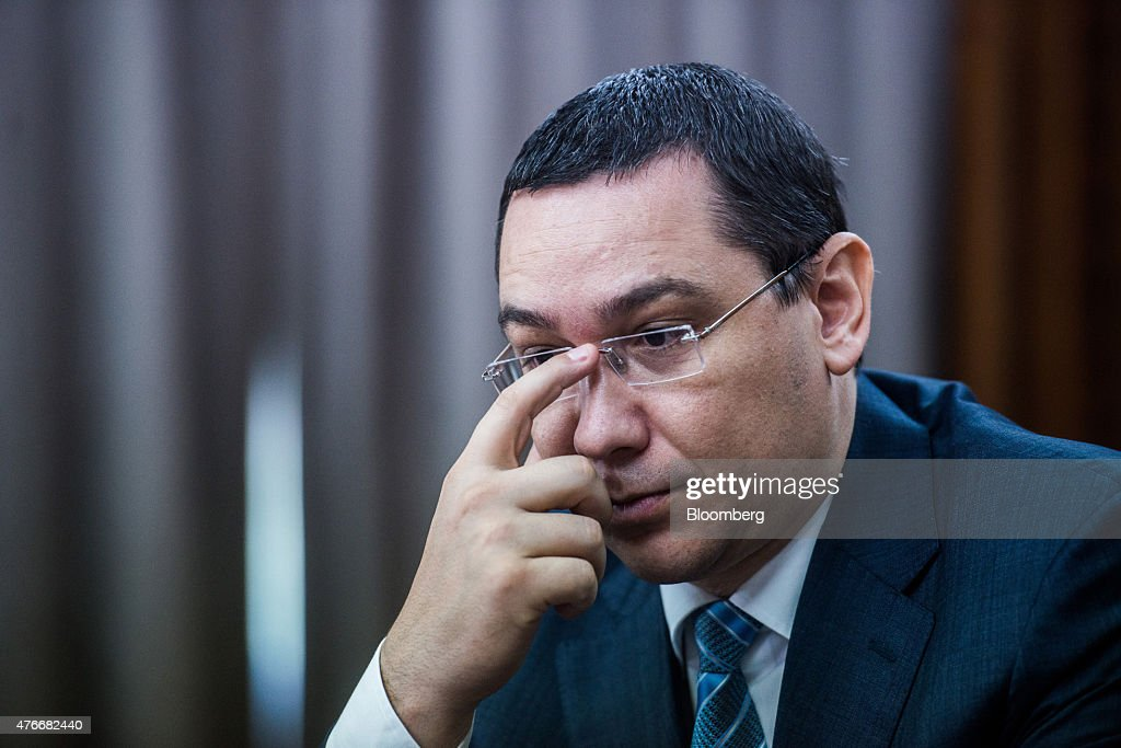 Victor Ponta, Romania's prime minister, pauses during an interview at the Victoria Palace in Bucharest, Romania, on Thursday, June 11, 2015. A protracted political crisis in Romania would threaten to slow the European Unions fastest economic growth, according to Ponta, who faces a no-confidence motion on Friday. Photographer: Akos Stiller/Bloomberg via Getty Images