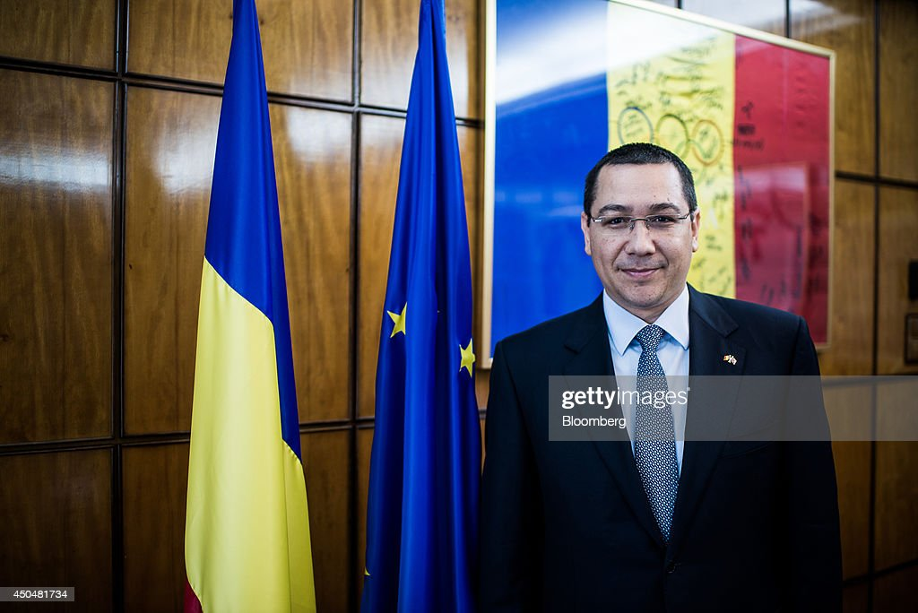 Victor Ponta, Romania's prime minister, poses for a photograph at the Victoria Palace in Bucharest, Romania, on Thursday, June 12, 2014. Romania is considering the sale in 2015 of further shares in state-controlled companies including Transelectrica SA, Romgaz SA and Transgaz SA, according to Ponta, who said the government may be left with stakes of less than 50 percent in some. Photographer: Akos Stiller/Bloomberg via Getty Images