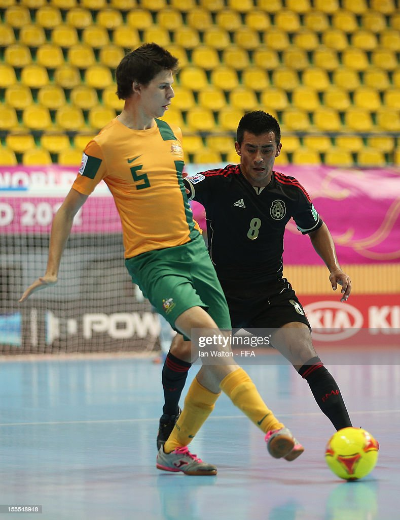 Victor Quiroz of Mexico tries to tackle Nathan Niski (L) of Australia during the FIFA Futsal World Cup Thailand 2012, Group D match between Australia and Mexico at Nimibutr Stadium on November 5, 2012 in Bangkok, Thailand.