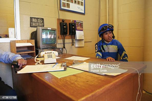 Victor R Carrasco jockey of Picko's Pride sits at a desk following being weighed in prior to The Maryland Sprint Handicap at Pimlico Race Course on...