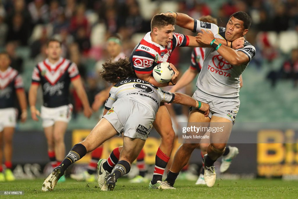 Victor Radley of the Roosters is tackled during the round 21 NRL match between the Sydney Roosters and the North Queensland Cowboys at Allianz Stadium on July 29, 2017 in Sydney, Australia.