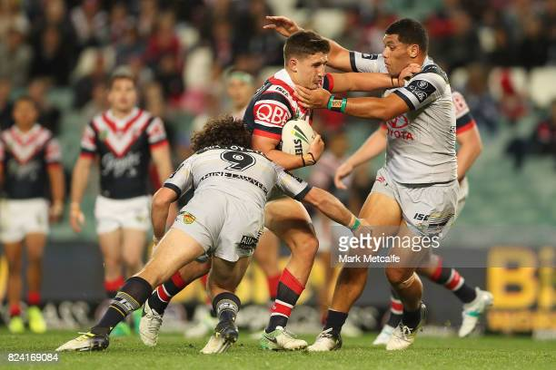 Victor Radley of the Roosters is tackled during the round 21 NRL match between the Sydney Roosters and the North Queensland Cowboys at Allianz...