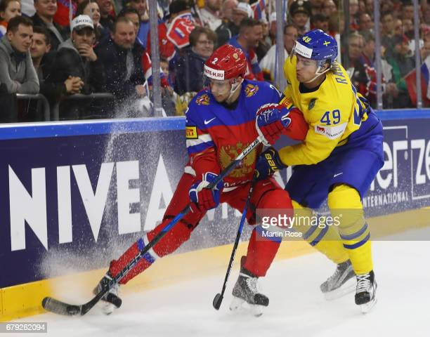 Victor Rask of Sweden challenges Artyom Zub of Russia during the 2017 IIHF Ice Hockey World Championship game between Sweden and Russia at Lanxess...