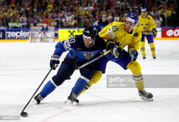 Victor Rask of Sweden challenges Julius Honka of Finland for the puck during the 2017 IIHF Ice Hockey World Championship semi final game between...
