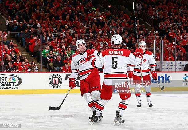 Victor Rask of the Carolina Hurricanes celebrates with Noah Hanifin after scoring in the third period of the NHL game against the Chicago Blackhawks...