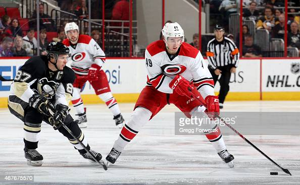 Victor Rask of the Carolina Hurricanes controls the puck away from Sidney Crosby of the Pittsburgh Penguins during their NHL game at PNC Arena on...
