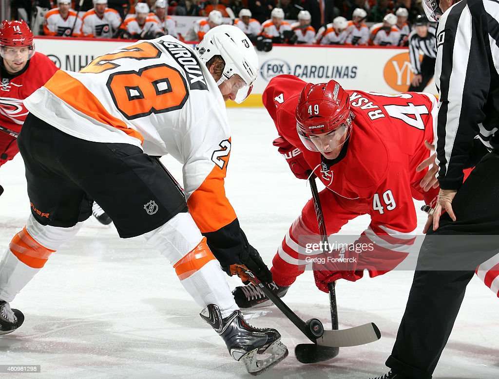 Victor Rask of the Carolina Hurricanes faces off against Claude Giroux of the Philadelphia Flyers during their NHL game at PNC Arena on January 2...