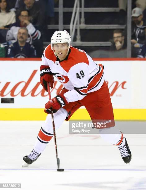 Victor Rask of the Carolina Hurricanes plays the puck down the ice during third period action against the Winnipeg Jets at the Bell MTS Place on...