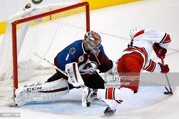 Victor Rask of the Carolina Hurricanes puts the puck past goalie Semyon Varlamov of the Colorado Avalanche for the game winning goal in overtime at...