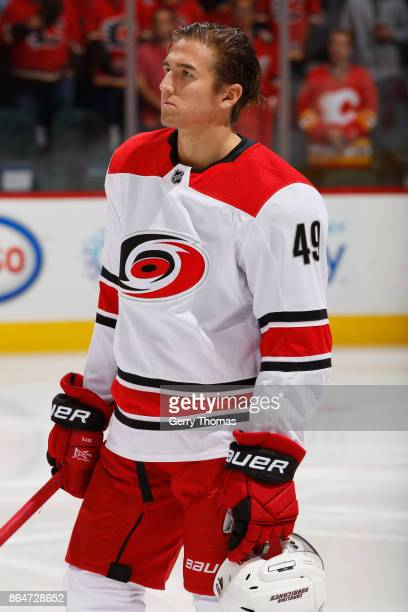 Victor Rask of the Carolina Hurricanes stands for the anthem against the Calgary Flames at Scotiabank Saddledome on October 19 2017 in Calgary...