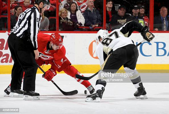 Victor Rask of the Carolina Hurricanes wins a face off against Sidney Crosby of the Pittsburgh Penguins during their NHL game at PNC Arena on...