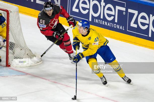 Victor Rask vies with Mark Scheifele during the Ice Hockey World Championship Gold medal game between Canada and Sweden at Lanxess Arena in Cologne...