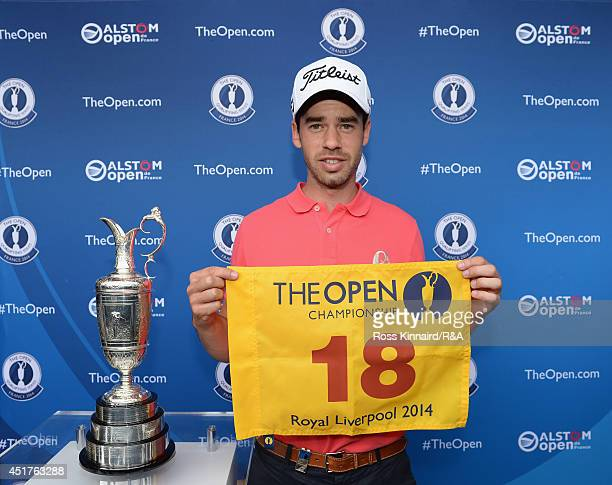 Victor Riu of France is presented with a Open Championship flag and his players badge after the final round of the Alstom Open De France at Le Golf...