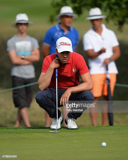 Victor Riu of France lines up his putt on the 3rd green during the Alstom Open de France Day Four at Le Golf National on July 5 2015 in Paris France