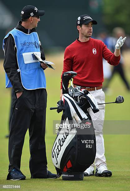 Victor Riu of France looks on with his caddie during a practice round prior to the start of The 143rd Open Championship at Royal Liverpool on July 16...