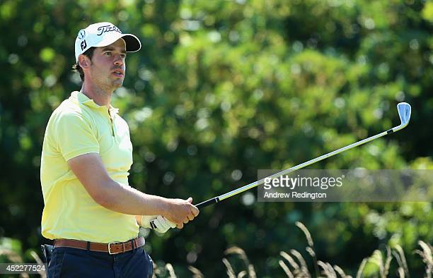 Victor Riu of France watches his tee shot on the 11th hole during the first round of The 143rd Open Championship at Royal Liverpool on July 17 2014...