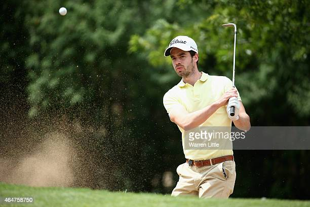Victor Riu of Frances plays out of the first greenside bunkner during the third round of the Joburg Open at Royal Johannesburg and Kensington Golf...