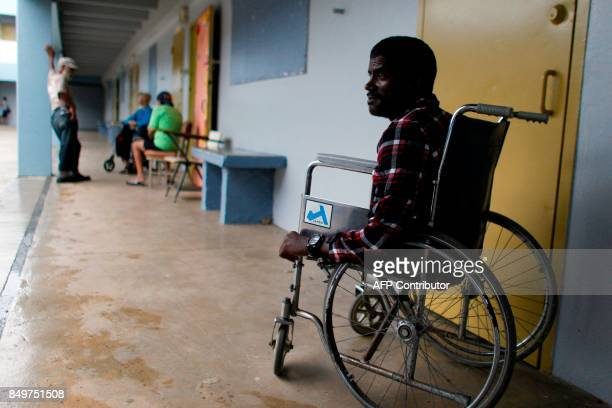 Victor Rivera sits in his wheelchair at a shelter as Hurricane Maria approaches Puerto Rico in Fajardo on September 19 2017 Maria headed towards the...