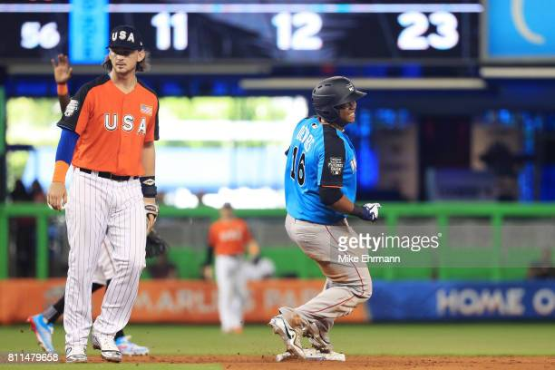 Victor Robles of the Washington Nationals and the World Team steals second against Brendan Rodgers of the Colorado Rockies and the US Team during the...