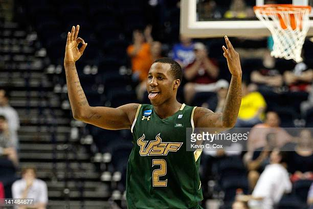 Victor Rudd Jr #2 of the South Florida Bulls celebrates after a play against the Temple Owls during the second round of the 2012 NCAA Men's...