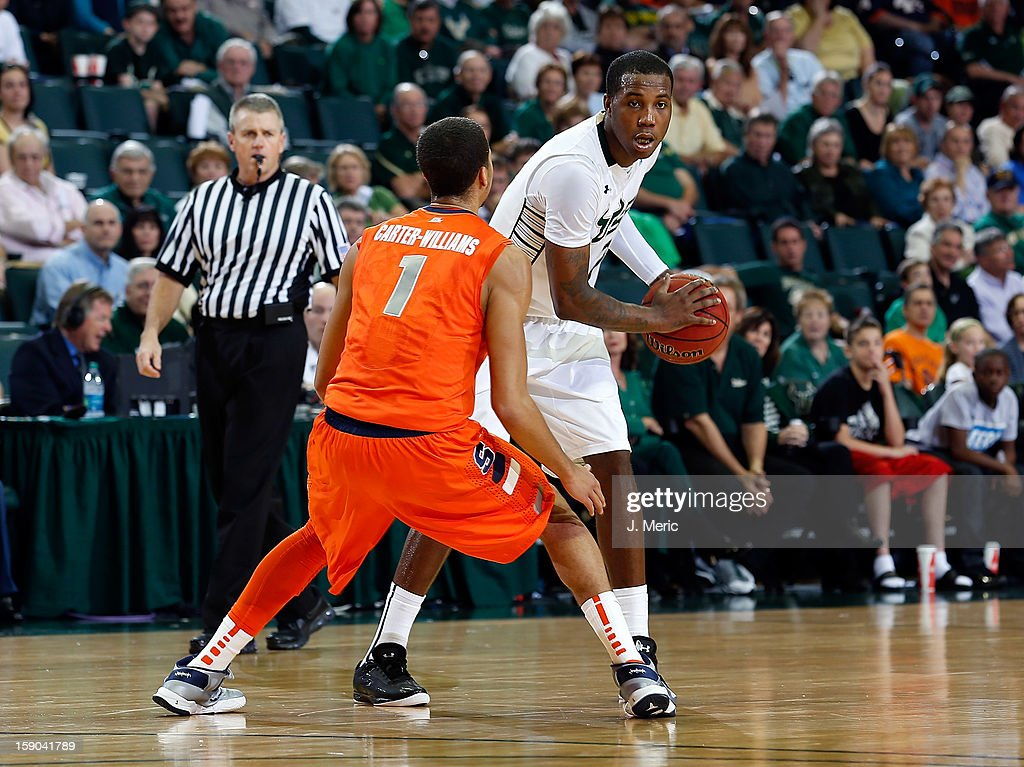 Victor Rudd #2 of the South Florida Bulls brings the ball up the court as <a gi-track='captionPersonalityLinkClicked' href=/galleries/search?phrase=Michael+Carter-Williams&family=editorial&specificpeople=7621167 ng-click='$event.stopPropagation()'>Michael Carter-Williams</a> #1 of the Syracuse Orange defends during the game at the Sun Dome on January 6, 2013 in Tampa, Florida.