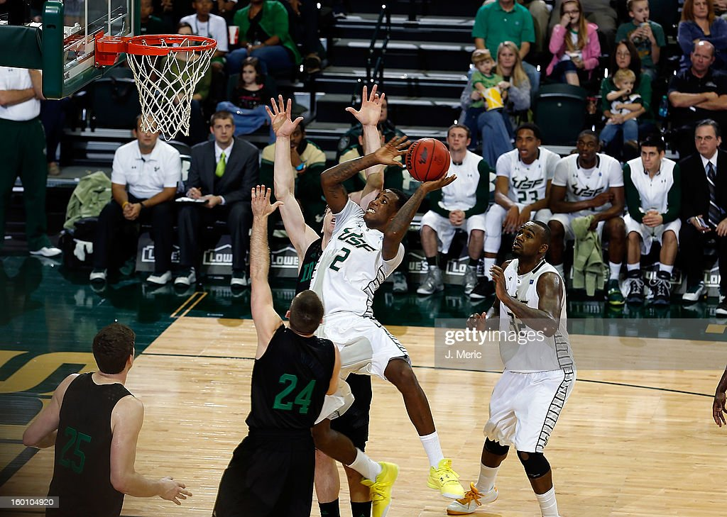 Victor Rudd #2 of the South Florida Bulls drives between defenders Pat Connaughton #24 and Jack Cooley #45 of the Notre Dame Fighting Irish during the game at the Sun Dome on January 26, 2013 in Tampa, Florida.