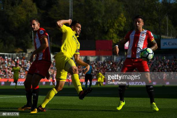Victor Ruiz of Villarreal CF competes for the ball with Cristhian Stuani and Aday Benitez of Girona FC during the La Liga match between Girona and...