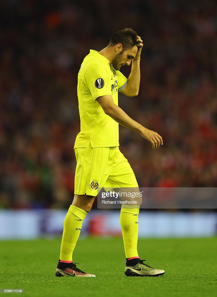 Victor Ruiz of Villarreal looks dejected as he is sent off during the UEFA Europa League semi final second leg match between Liverpool and Villarreal CF at Anfield on May 5, 2016 in Liverpool, England.