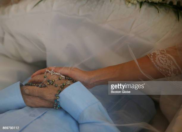 Victor Ruiz Ramos' daughter reaches out to place her hand on his during his wake in Corozal Puerto Rico on Oct 02 2017 After Hurricane Maria Ruiz...
