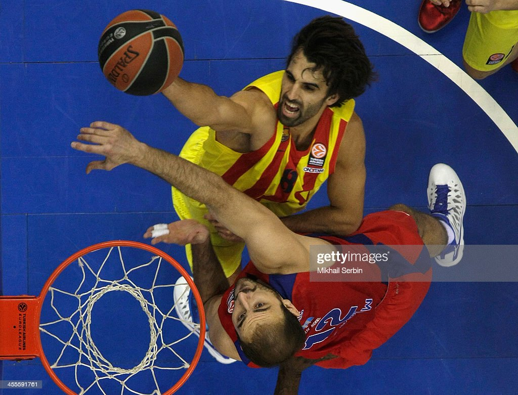 Victor Sada, #8 of FC Barcelona competes with <a gi-track='captionPersonalityLinkClicked' href=/galleries/search?phrase=Nenad+Krstic&family=editorial&specificpeople=202625 ng-click='$event.stopPropagation()'>Nenad Krstic</a>, #12 of CSKA Moscow in action during the 2013-2014 Turkish Airlines Euroleague Regular Season Date 9 game between CSKA Moscow v FC Barcelona at USH CSKA on December 12, 2013 in Moscow, Russia.