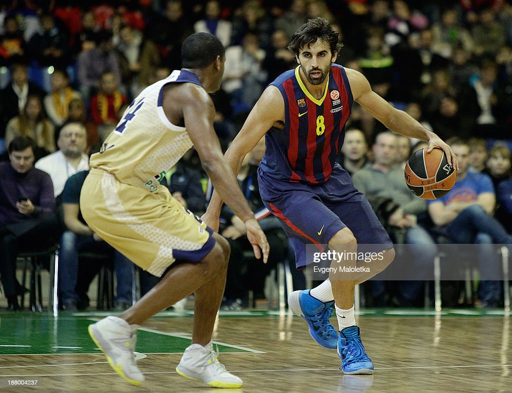 Victor Sada, #8 of FC Barcelona competes with <a gi-track='captionPersonalityLinkClicked' href=/galleries/search?phrase=Ricky+Minard&family=editorial&specificpeople=228899 ng-click='$event.stopPropagation()'>Ricky Minard</a>, #24 of Budivelnik Kiev during the 2013-2014 Turkish Airlines Euroleague Regular Season Date 5 game between Budivelnik Kiev v FC Barcelona at Kiev Palace of Sport on November 14, 2013 in Kiev, Ukraine.