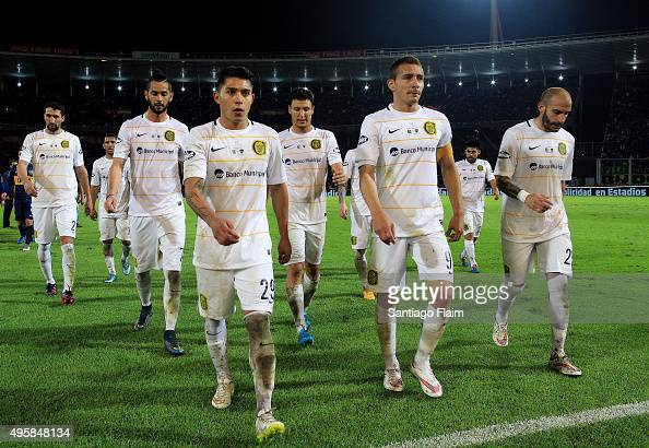 Victor Salazar of Rosario Central and his teammates walk out the field after losing a final match between Boca Juniors and Rosario Central as part of...