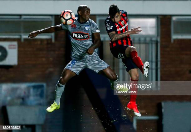 Victor Salazar of San Lorenzo fights for the ball with Oscar Bagui of Emelec during a second leg match between San Lorenzo and Emelec as part of...
