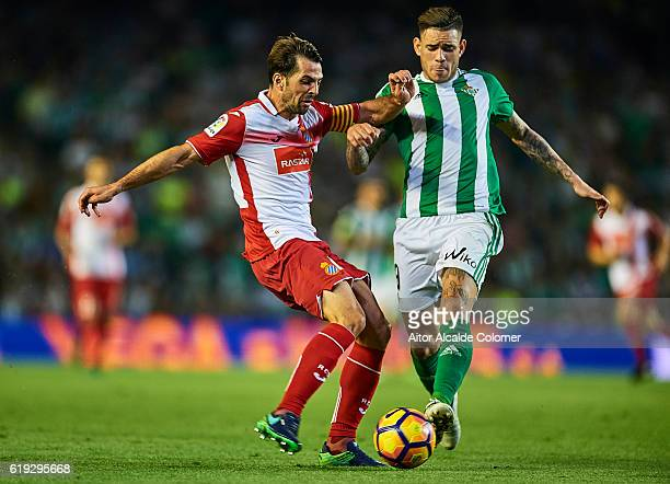 Victor Sanchez of RCD Espanyol competes for the ball with Arnaldo Antonio Sanabria of Real Betis Balompie during the match between Real Betis...
