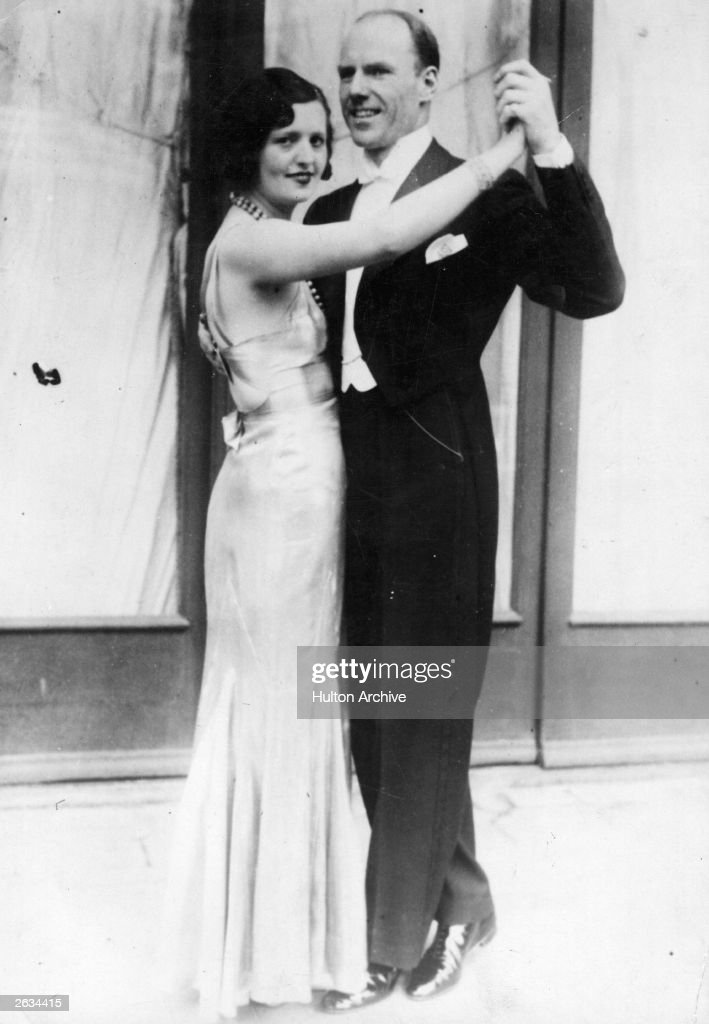 Victor Silvester (1900 - 1978), the English ballroom dancer whose name became synonymous with strict tempo dance music, dancing with Mrs Silvester at the championships being held in Germany. Original Publication: People Disc - HM0278
