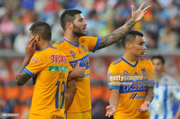 Victor Sosa Andre Gignac and Lucas Zalarayan of Tigres receive instructions during their Mexican Apertura 2017 Tournament football match at Hidalgo...