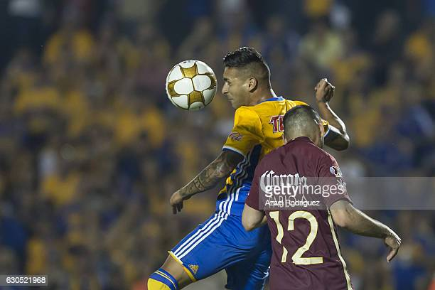 Victor Sosa of Tigres heads the ball over Pablo Aguilar of America during the Final second leg match between Tigres UANL and America as part of the...