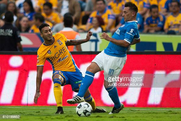 Victor Sosa of Tigres vies for the ball with Christian Gimenez of Cruz Azul during their Mexican Apertura 2016 tournament football match at the...