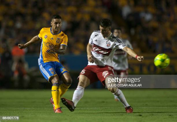 Victor Sosa of Tigres vies for the ball with Guido Rodriguez of Tijuana during the first leg of semifinal of Mexican Clausura 2017 tournament...
